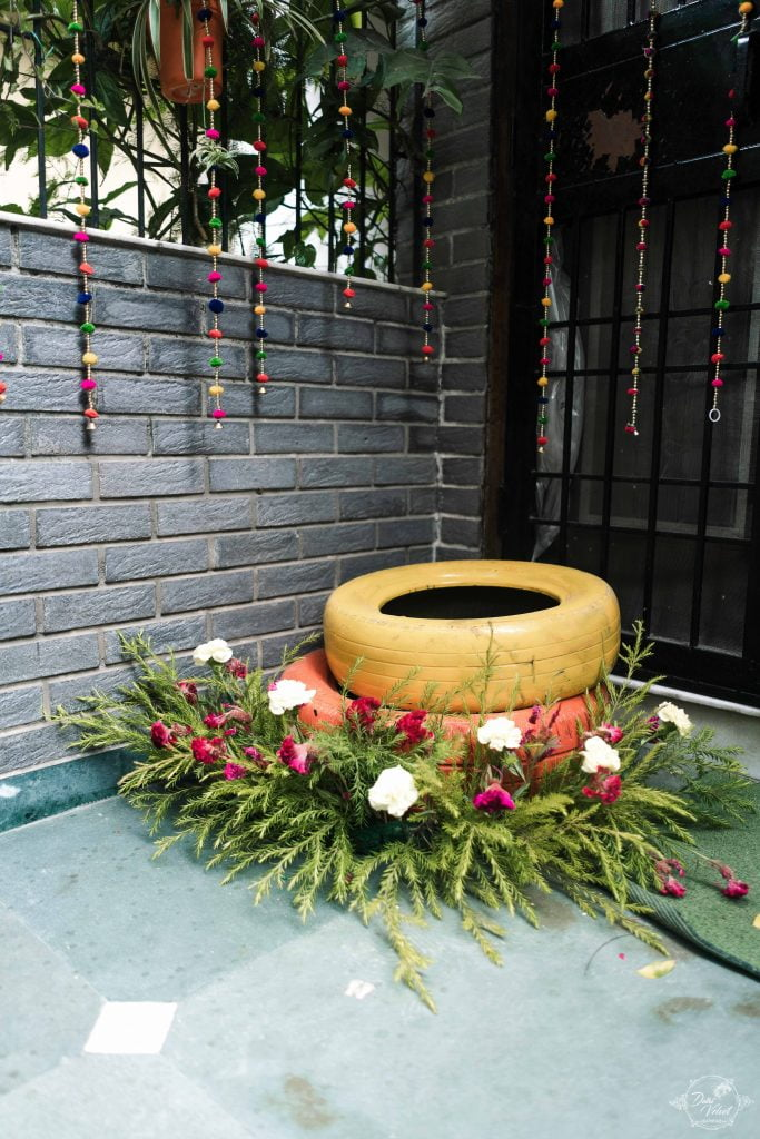 rustic painted tyres with flower bushes for indoor home decor