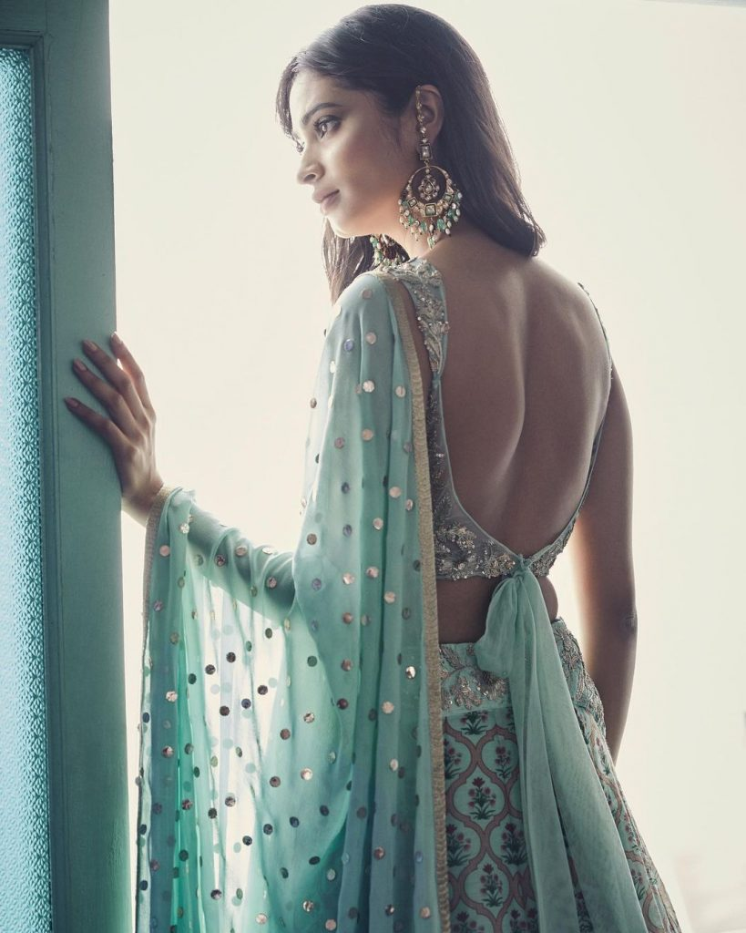 Elegant Backless Self Tie Up Latest Blouse Design For Aquamarine Printed Lehenga