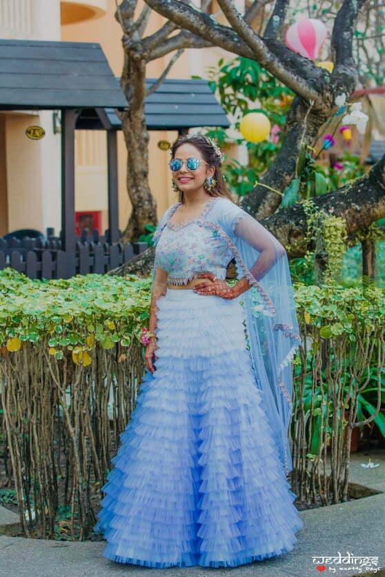 Shalini looking stunning in her aqua blue ruffled dress piece for her Hawaiian pool party at Hua Hin, Thailand