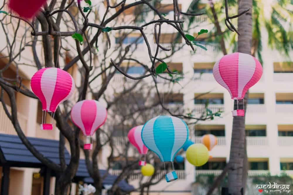 Cute mini parachute decor elements at the pool party before Shalini & Akhil's Dusit Thani Hua Hin wedding