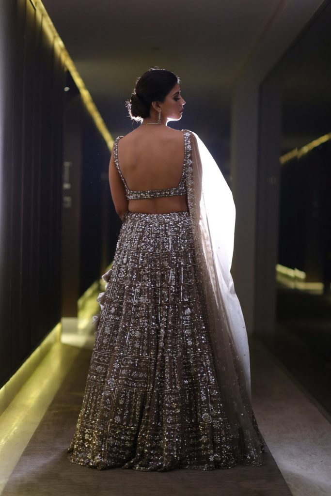 Deep Backless Blouse With Mirror Embellishments For Shimmery Lehenga