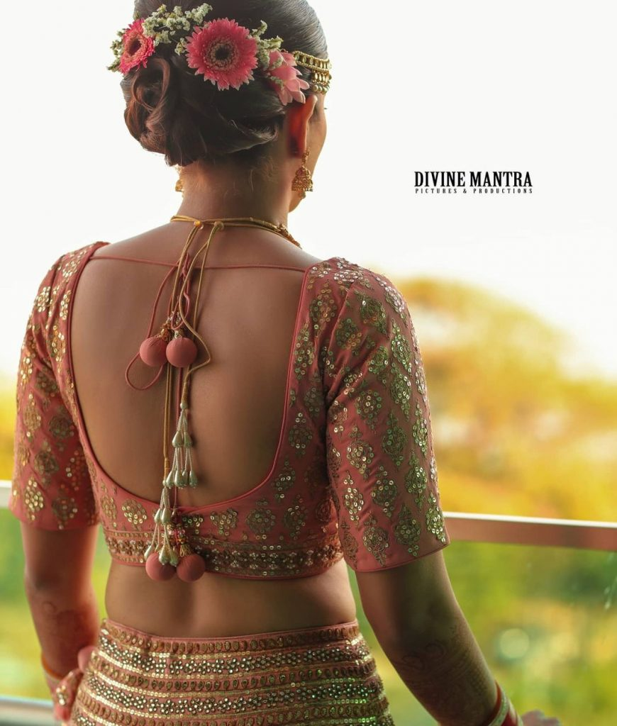 Gold sequined simple blouse back for peach heavy embroidered lehenga with pom pom latkans