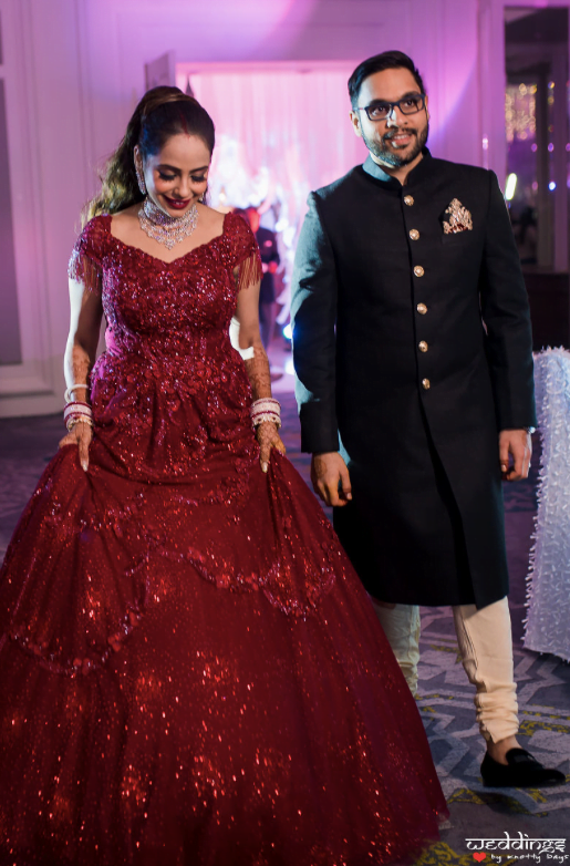 Shalini and Akhil glowing in their designer red bridal gown and sherwani for their Dusit Thani Hua Hin Wedding Reception