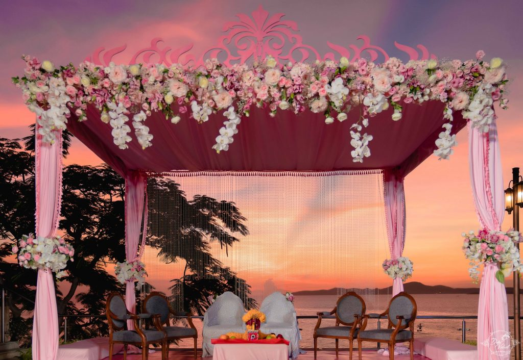 pink vidhi mandap decoration at beachside wedding