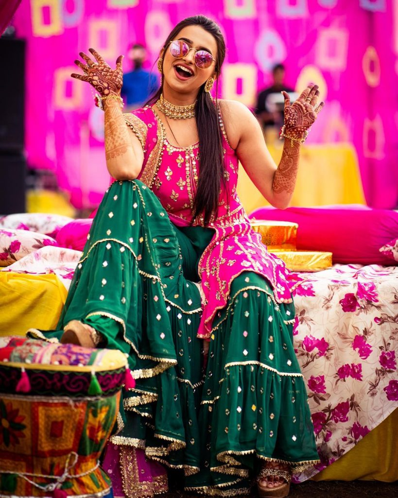 fun laughing bride in 90s green mehndi sharara outfits