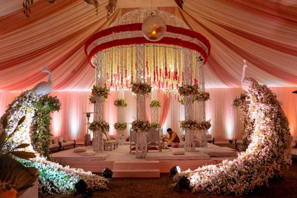 tent shaped mandap with floral peacock statues