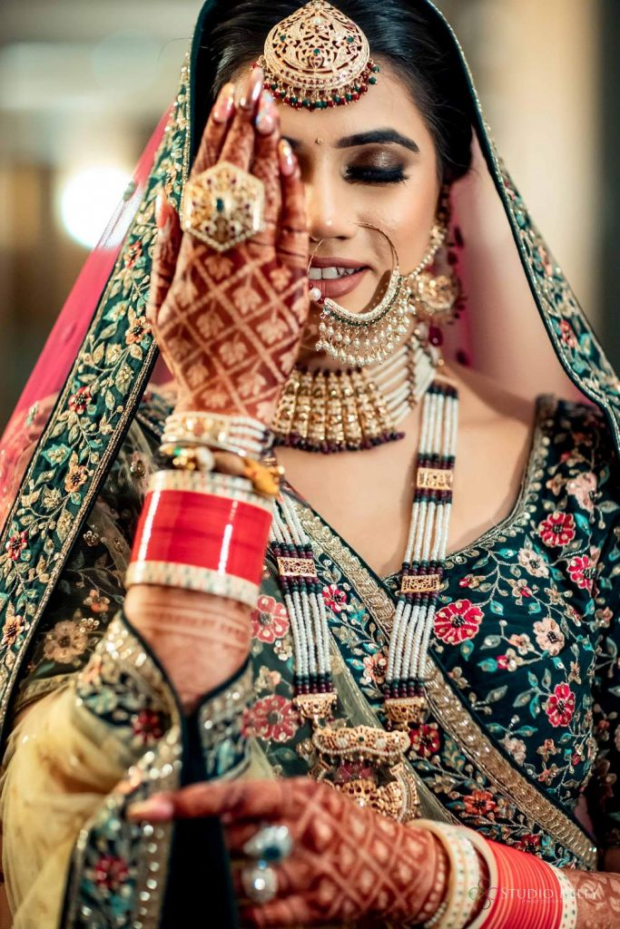 matching green jewellery with green lehenga