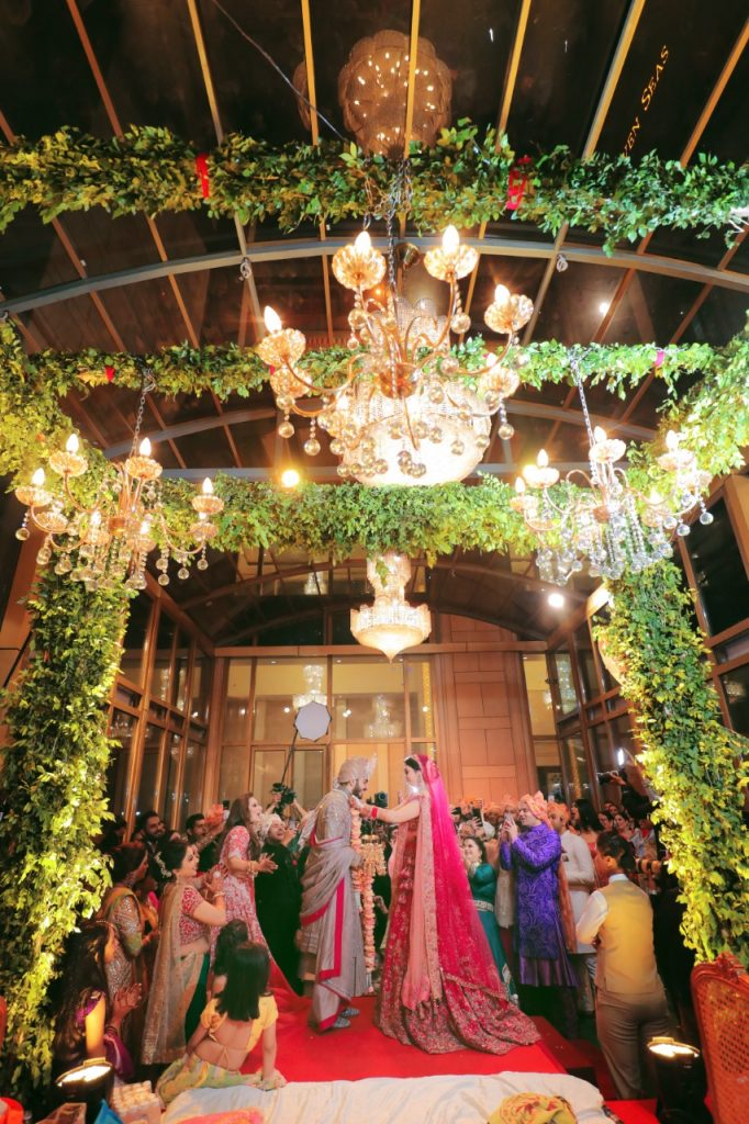 indoor mandap decoration idea with foliage and lights