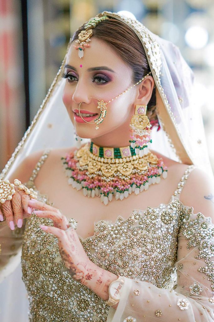 multi-colored jewellery with golden lehenga
