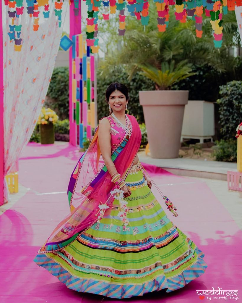 quirky mehendi green striped lehenga and pink choli