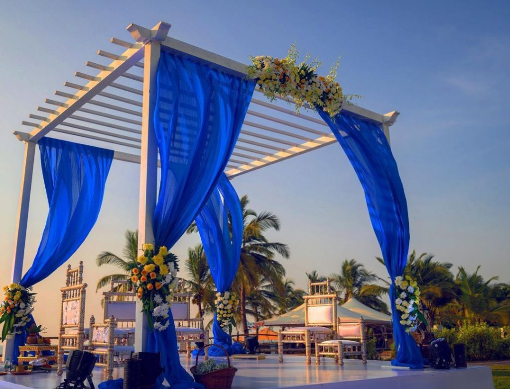 outdoor marriage mandap decoration with blue drapes