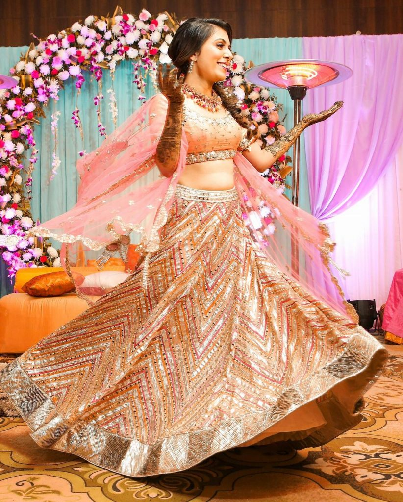 glitter pink mehendi ceremony dress code lehenga