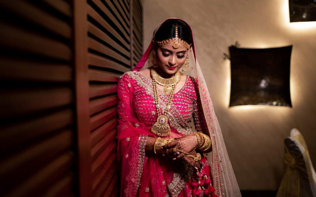 bridal pink lehenga with gold jewellery