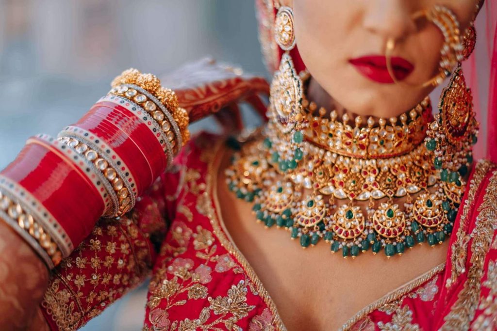 contrast green choker with red lehenga