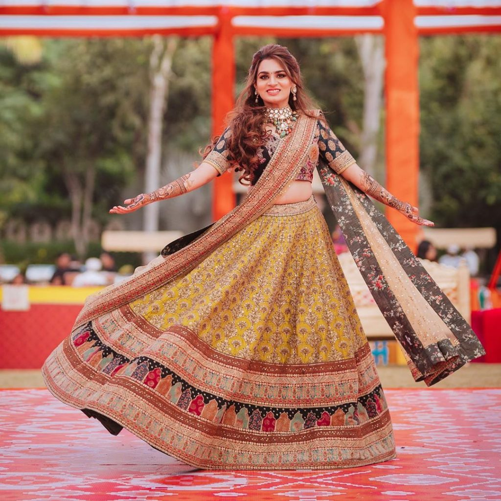 yellow blue embroidered sabyasachi mehendi lehenga for bride