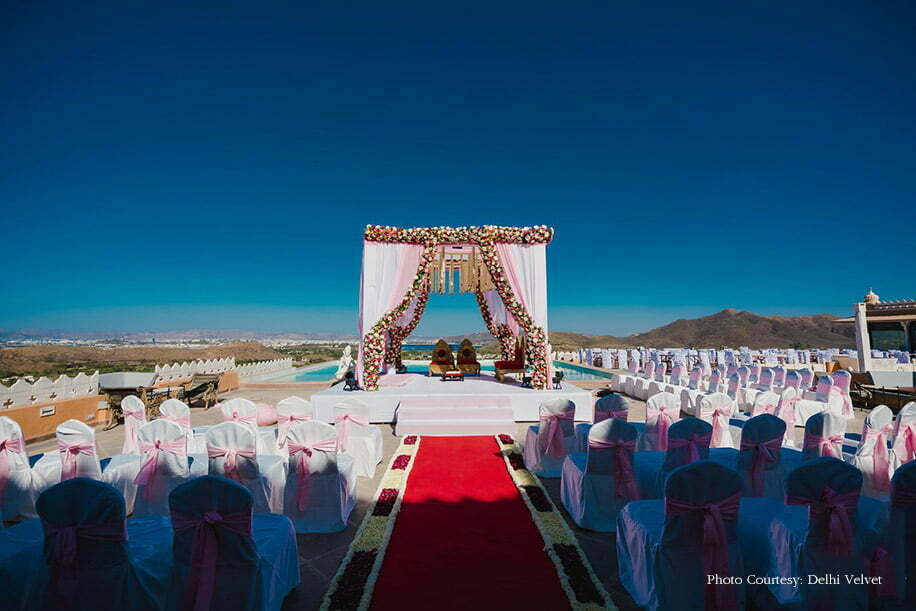 simple wedding mandap with drapes and flower lining