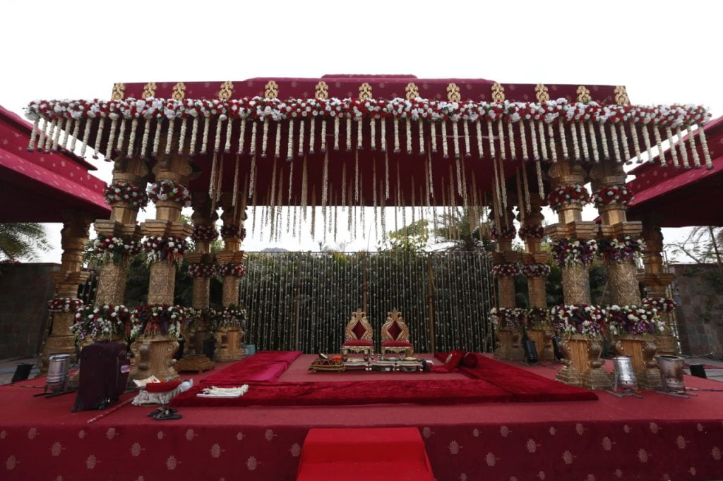 traditional vintage mandapam decoration in red and gold tones
