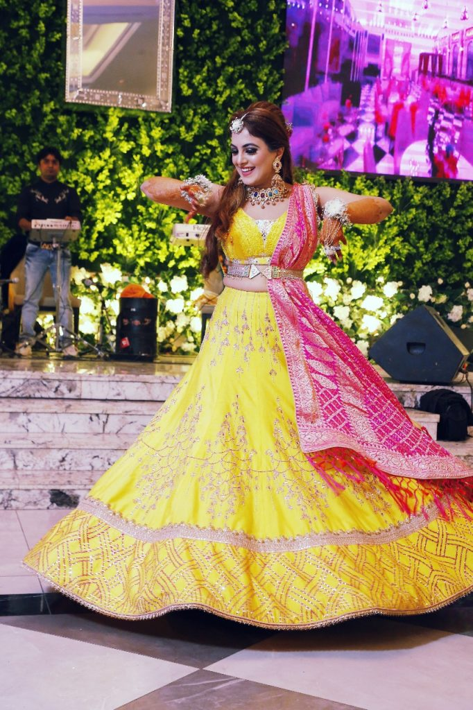 yellow lehenga with pink chunni designer mehendi outfits for bride
