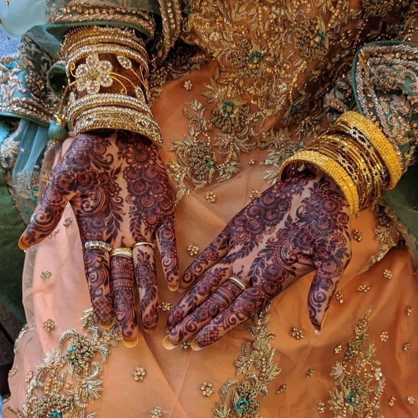 Elaborate Arabic Bridal Mehndi Design for Front Hand