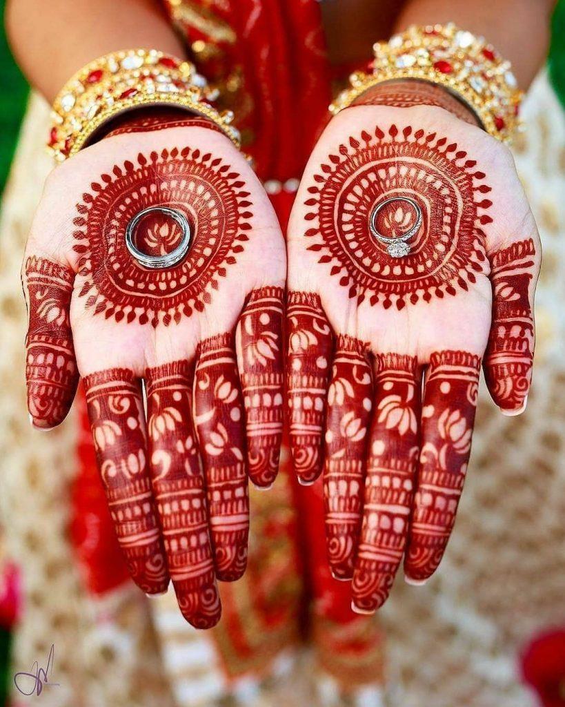 chakra bridal mehndi design with finger lotus motifs