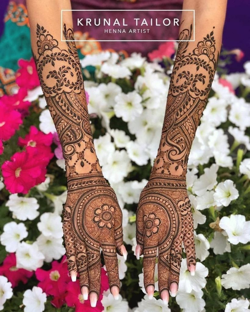 Detailed back hand mehandi with paisleys and flowers