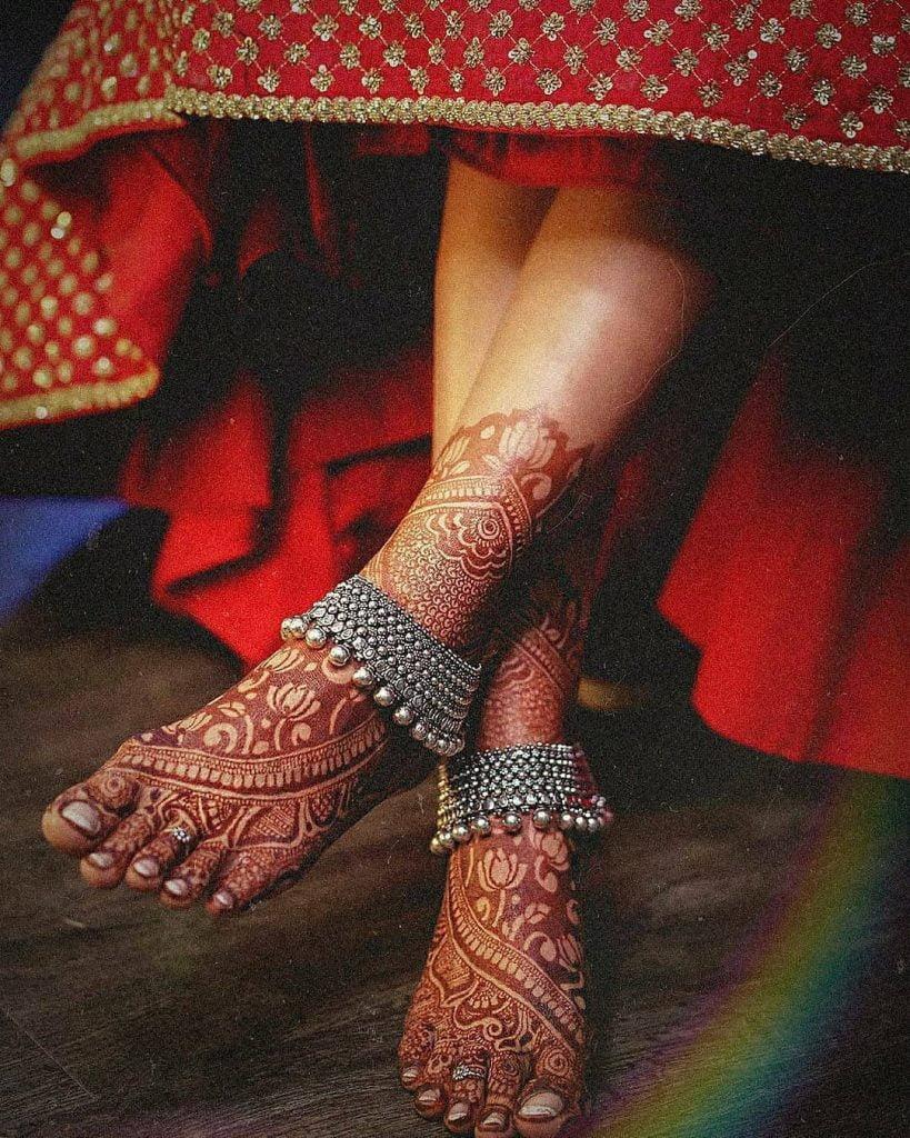 Side swept lotus motifs for feet mehandi design