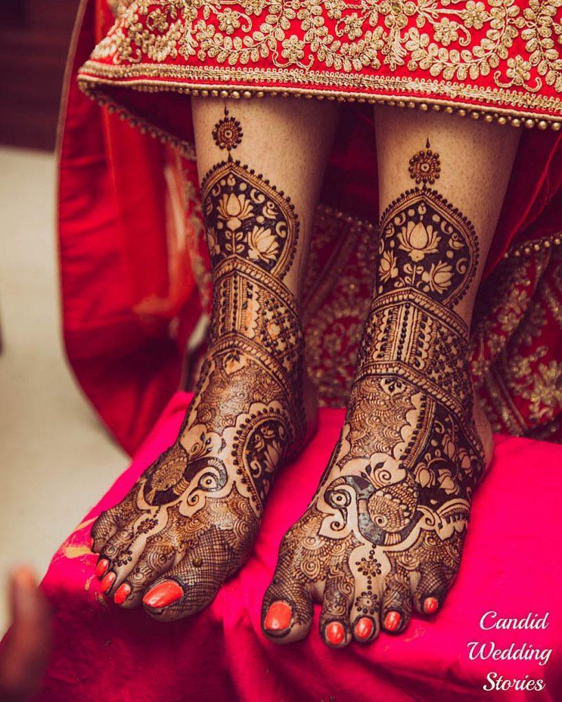 Layered peacock motif feet bridal mehndi design