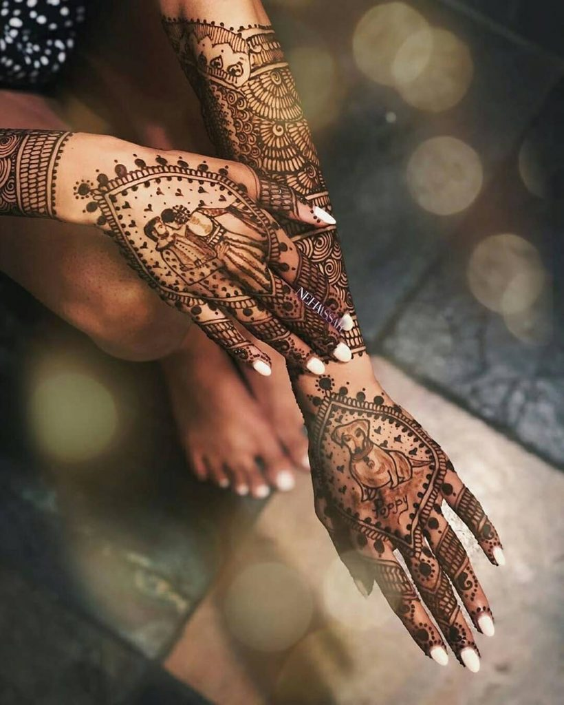 Personalized bridal mehndi design with portraits