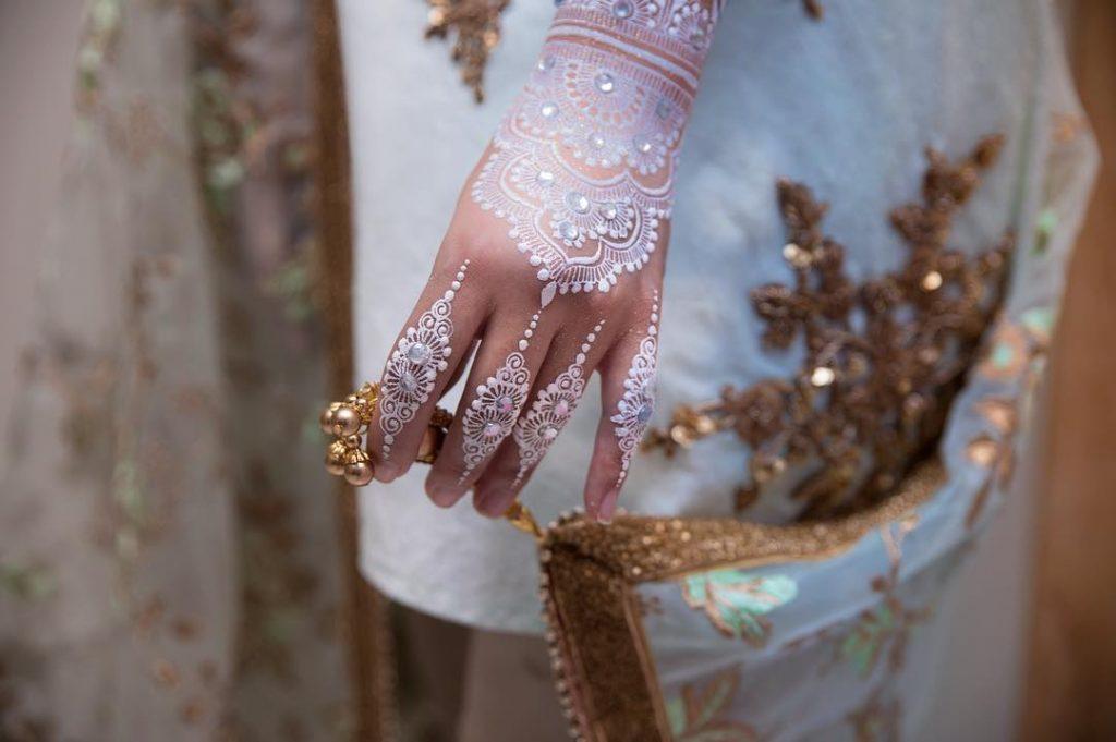 Back hand white mehendi with stones