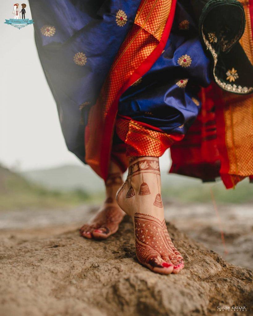 Lotus and Bell Motif Feet Mehandi Design