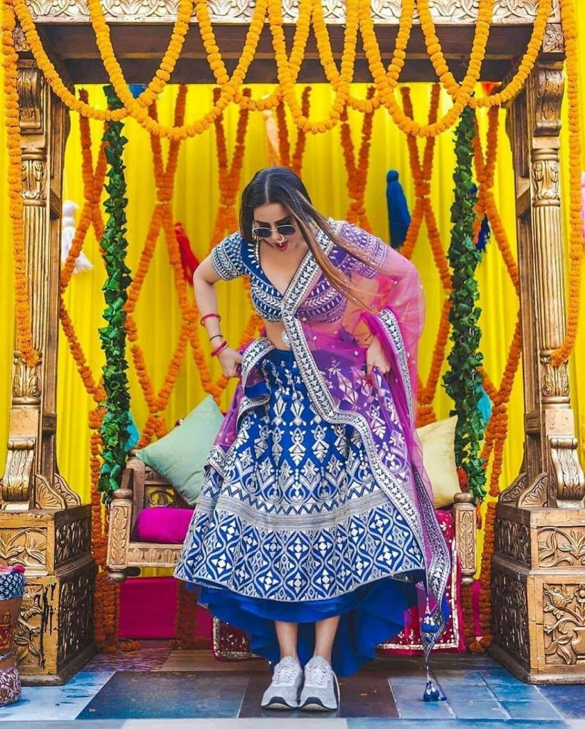 dark blue and pink lehenga combinations bride in sneakers