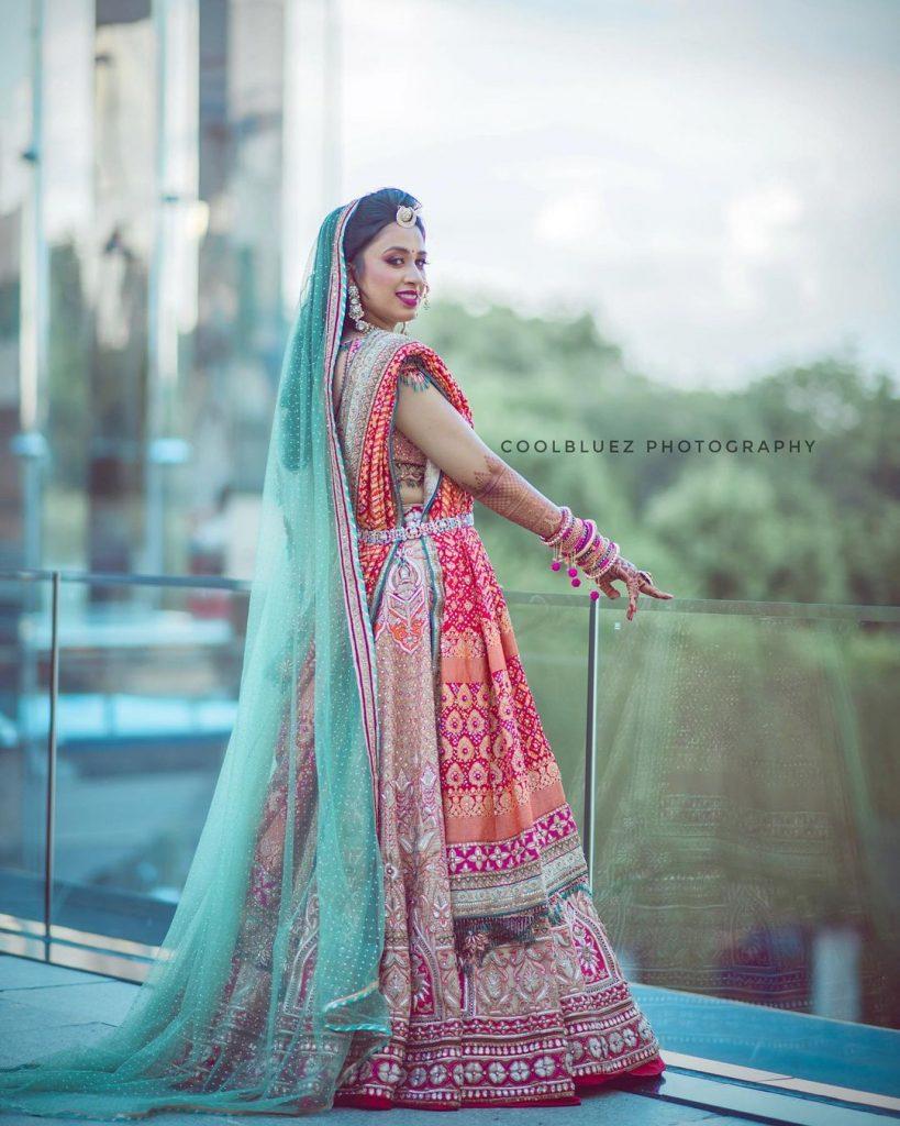 red and blue combination lehenga by Tarun Tahiliani