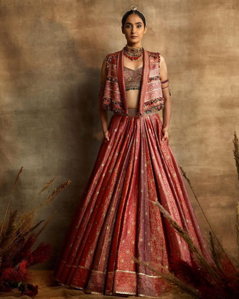 open front wide collared peach brocade jacket style lehenga