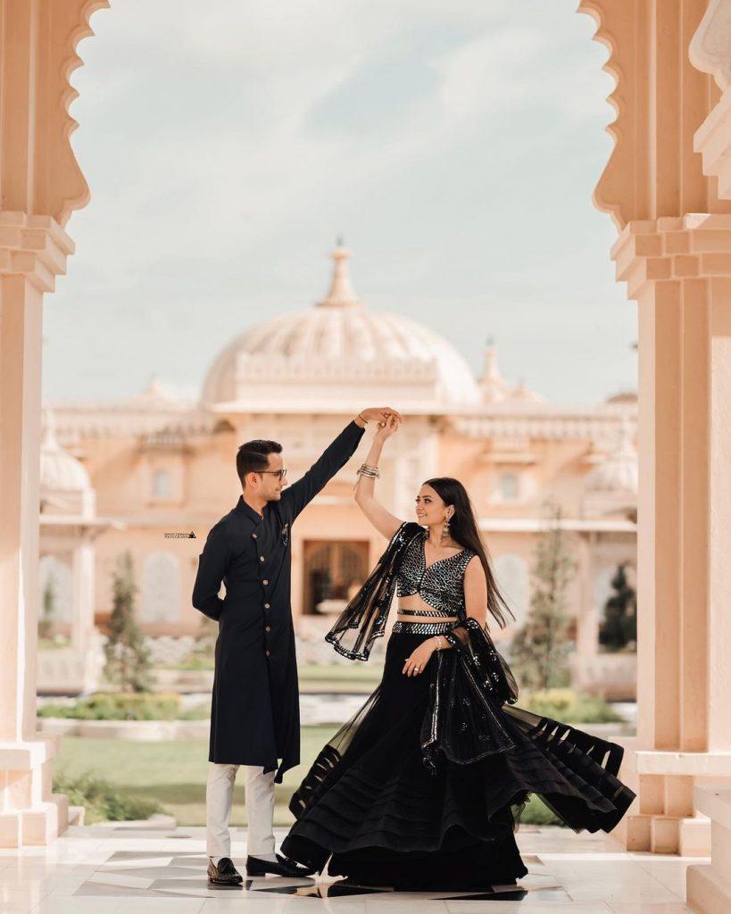 cute couple pose for pre wedding shoot
