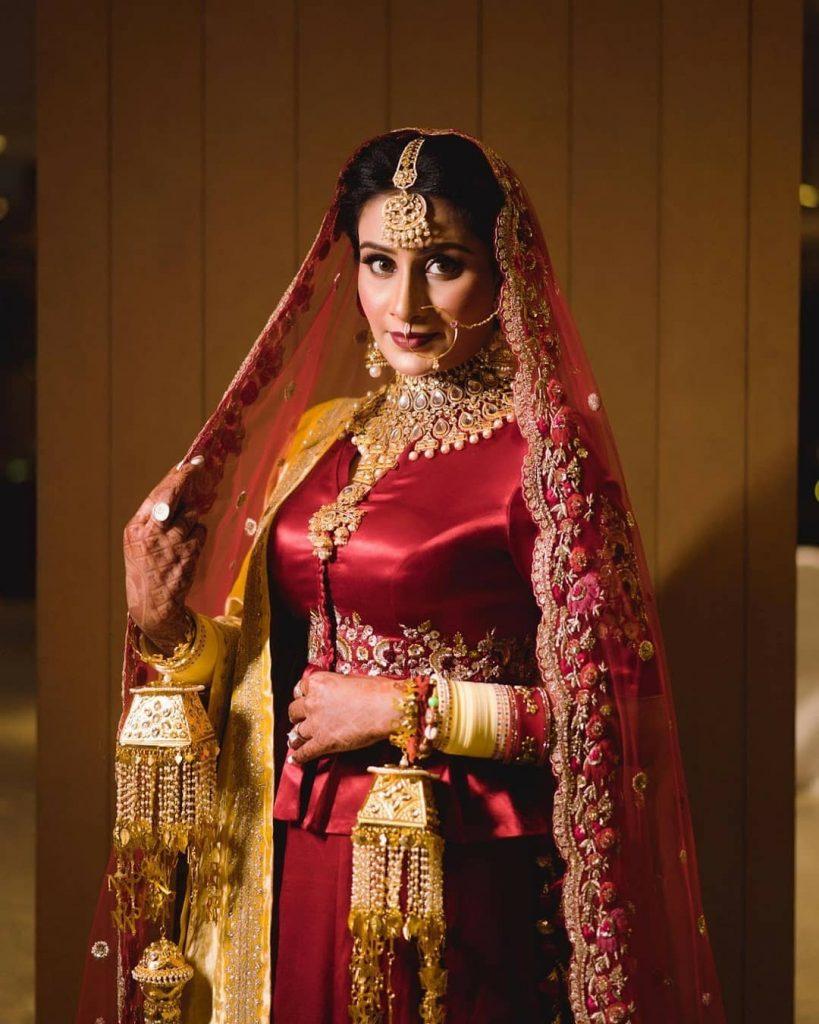 red raw silk bridal peplum style jacket lehenga for winter wedding