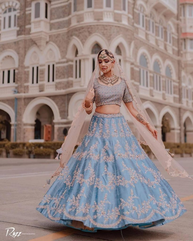 sky blue and pink lehenga colour combinations with golden embroidery and silver blouse