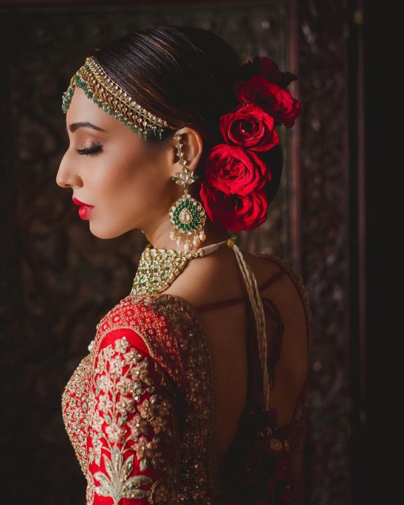 Indian bridal hairstyle for oval face with top-knot