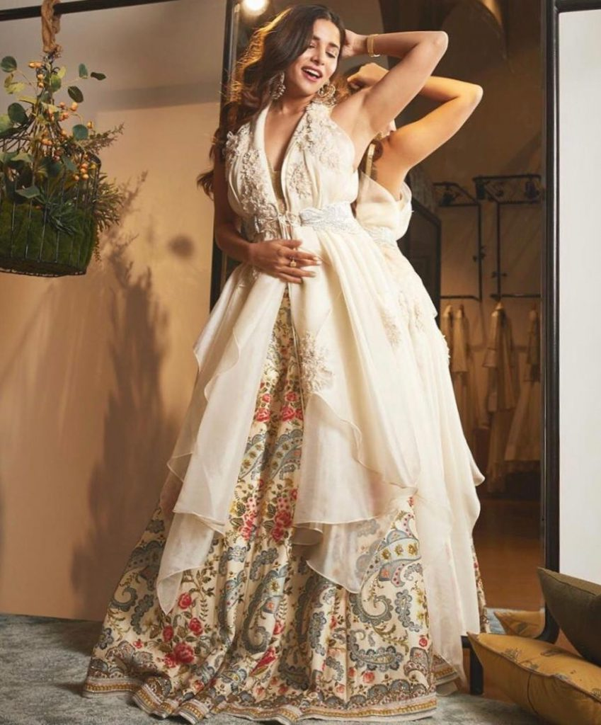 party wear lehenga with long asymmetrical belted white jacket
