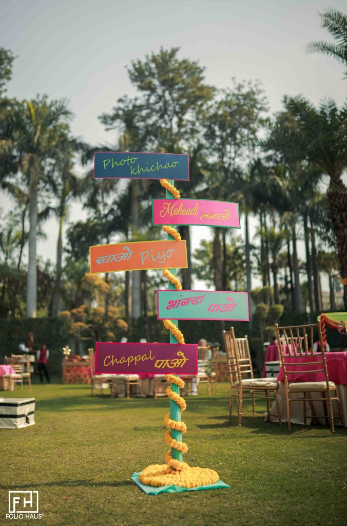 colourful signage decorated with marigolds for mehendi function