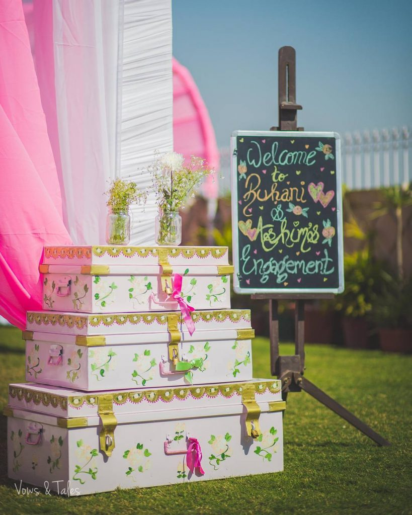 old trunks and blackboards painted and decorated with flowers as mehendi decoration ideas