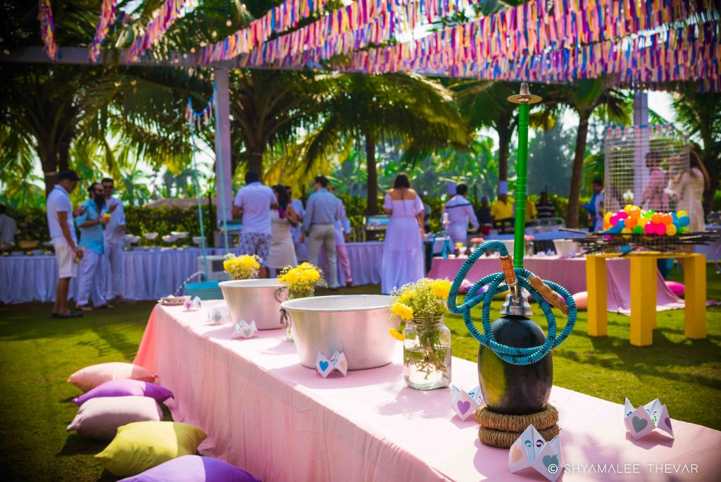 Modern mehndi décor in powder blue and pastel pink with fresh yellow flowers