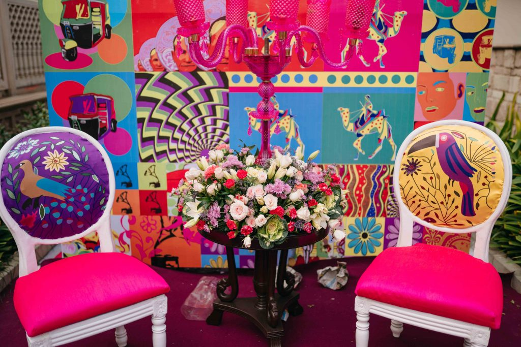 bohemian décor with animal printed chairs and flowers as decorations