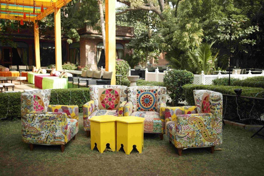 bohomian style seating arrangement in yellow colour palette as mehendi decoration ideas
