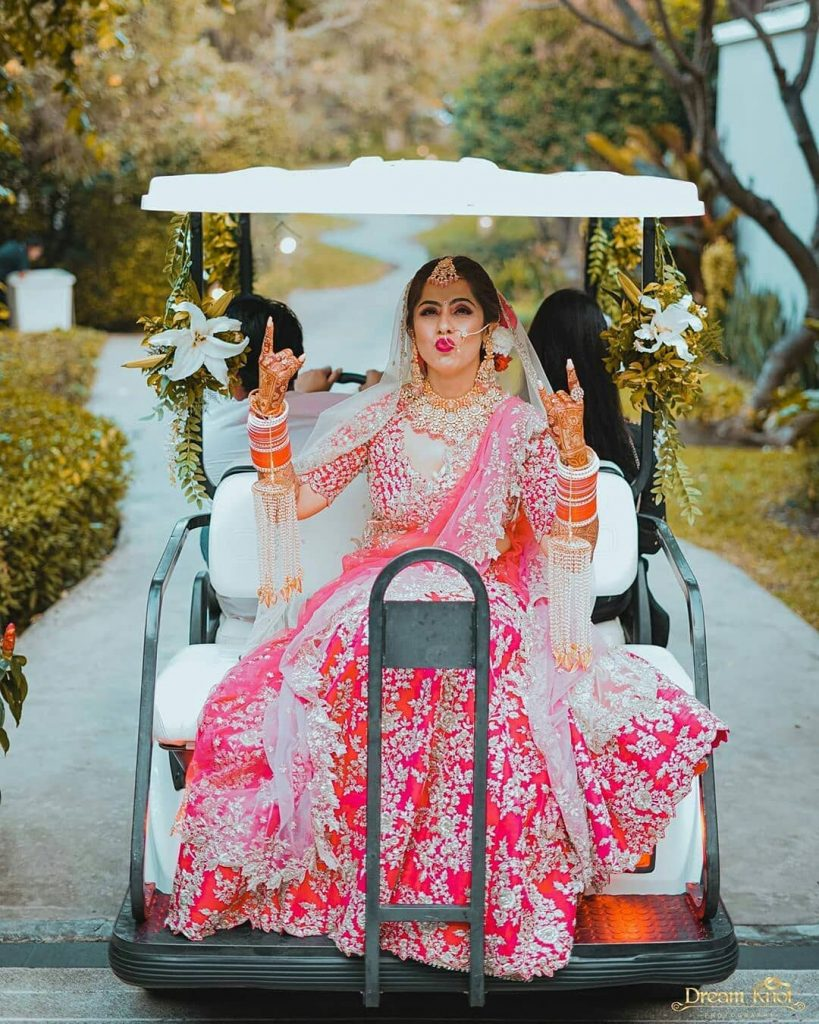 Quirky bridal entry in a golf cart