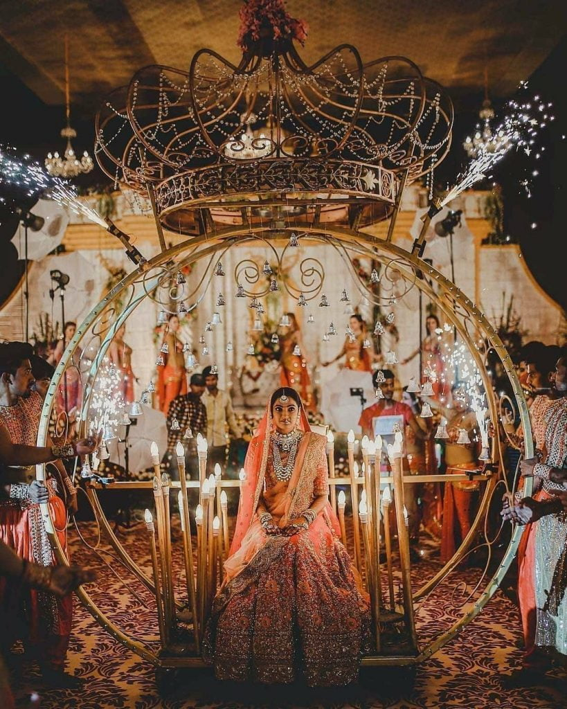 Dreamy bridal entry in a cinderella carriage