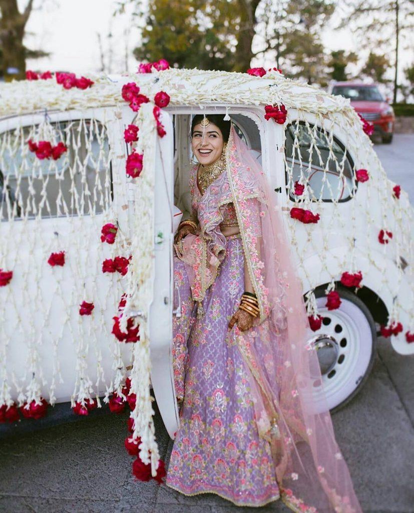 wedding entry idea for bride in a vintage car