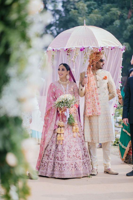 bridal entry with veiled umbrella