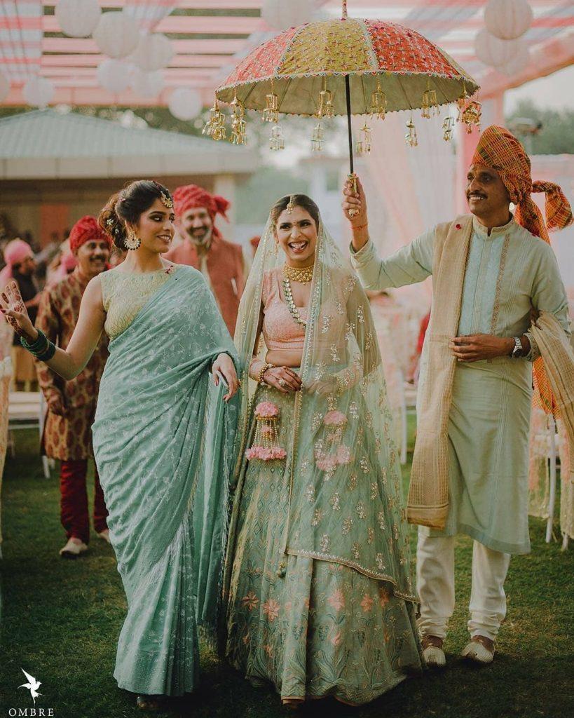 wedding entry under a fabric umbrella