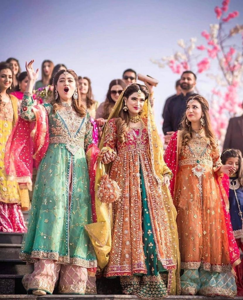 dulhan entry with her bridesmaids in color co-ordinated outfits