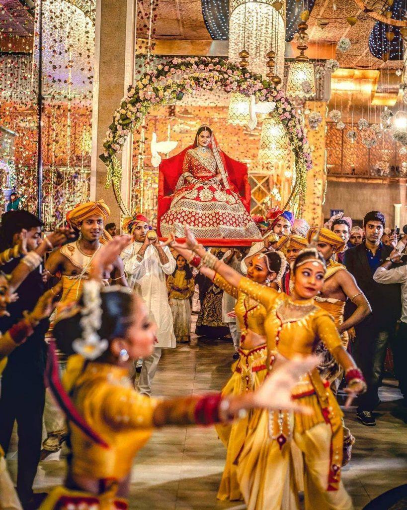 Unique floral doli bridal entry with dancers